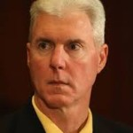ted thompson yellow shirt