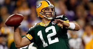 Aaron Rodgers prepares to pass