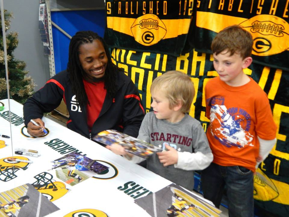 Green Bay Packers Davon House signing autographs