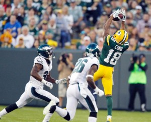 Green Bay Packers' Randall Cobb goes up for a pass during the first half of an NFL football game against the Philadelphia Eagles Saturday, August 29.