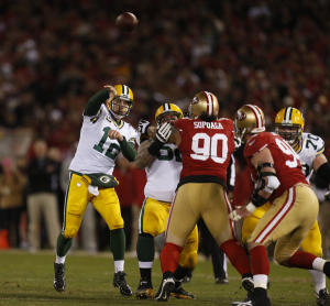 Green Bay Packers's starting quarterback Aaron Rodgers (12) throws against the San Francisco 49ers in the first quarter for the NFC divisional playoff game at Candlestick Park in San Francisco, Calif. on Saturday, Jan. 12, 2013.  (Nhat V. Meyer/Bay Area News Group)