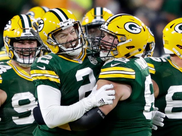 Packers K Mason Crosby celebrates a game-winning field goal over the 49ers