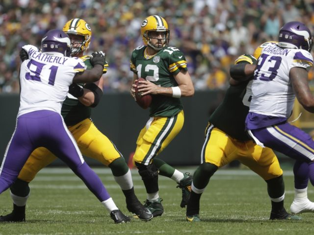 Packers' QB Aaron Rodgers looks to pass against the Minnesota Vikings